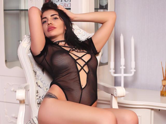 Foto van het sexy profiel van model SassyX, voor een zeer geile live webcam show!